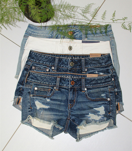 European and American fashion top goods womens summer Jeans Shorts light color loose show thin hole rough edge net red versatile hot pants