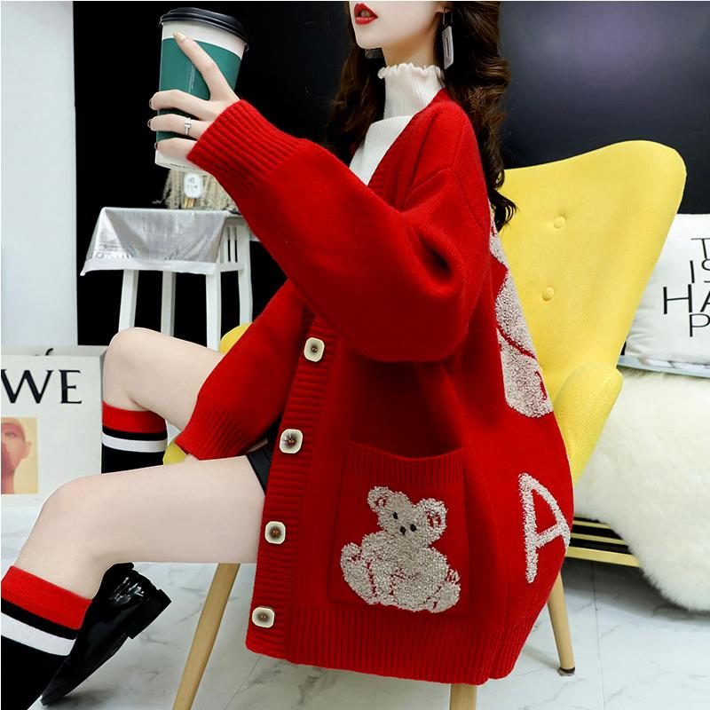 Mid long knitted cardigan womens autumn wear 2020 new foreign style net red super fire very fairy loose Korean jacket