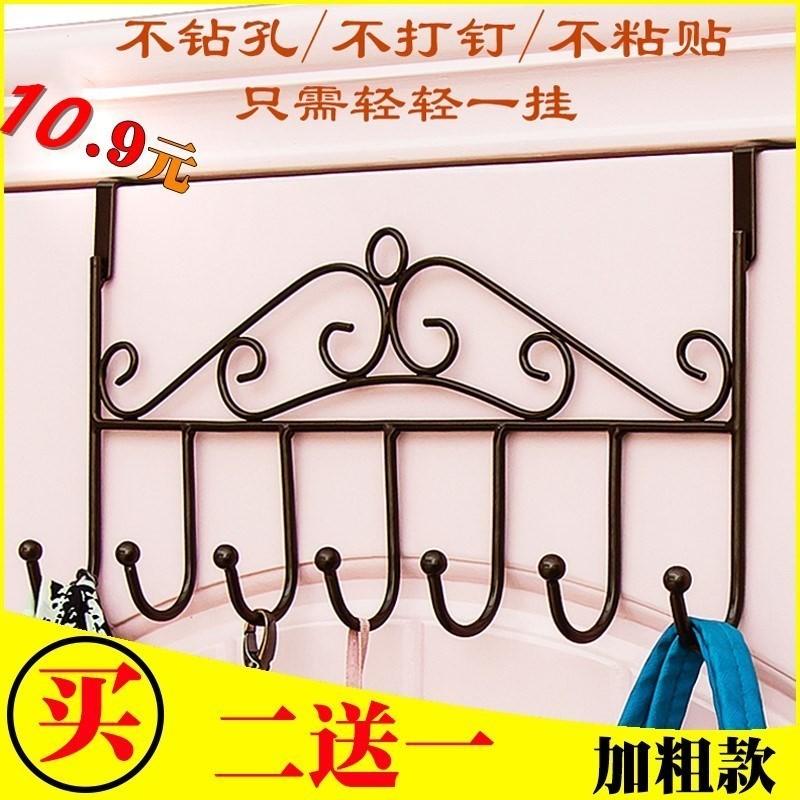 Behind the door behind the bedroom hanging on the door behind the door hanger no mark clothes hook toilet no holes