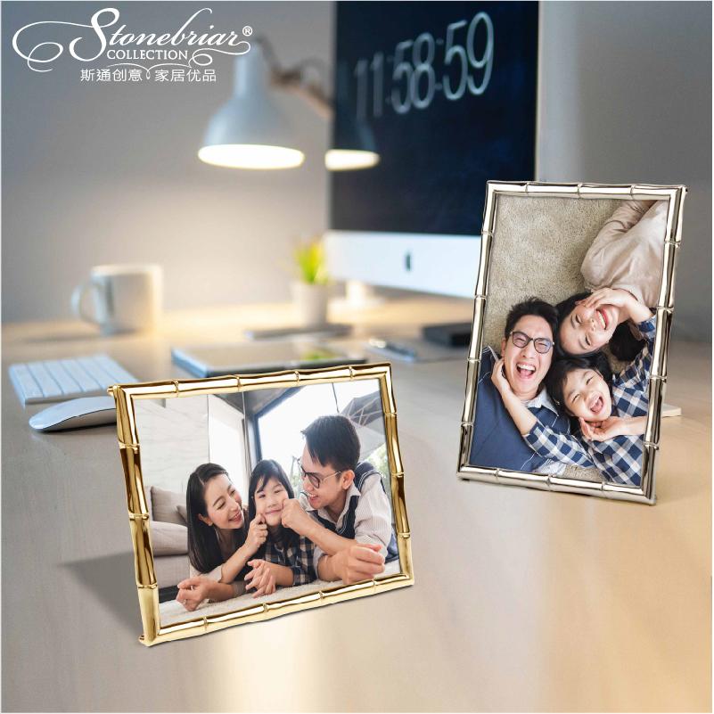 現代のシンプルな金銀色の金属竹の竹の節の額縁の陳列台の6寸の7寸の家庭の写真は互いに支え合いを飾ります。
