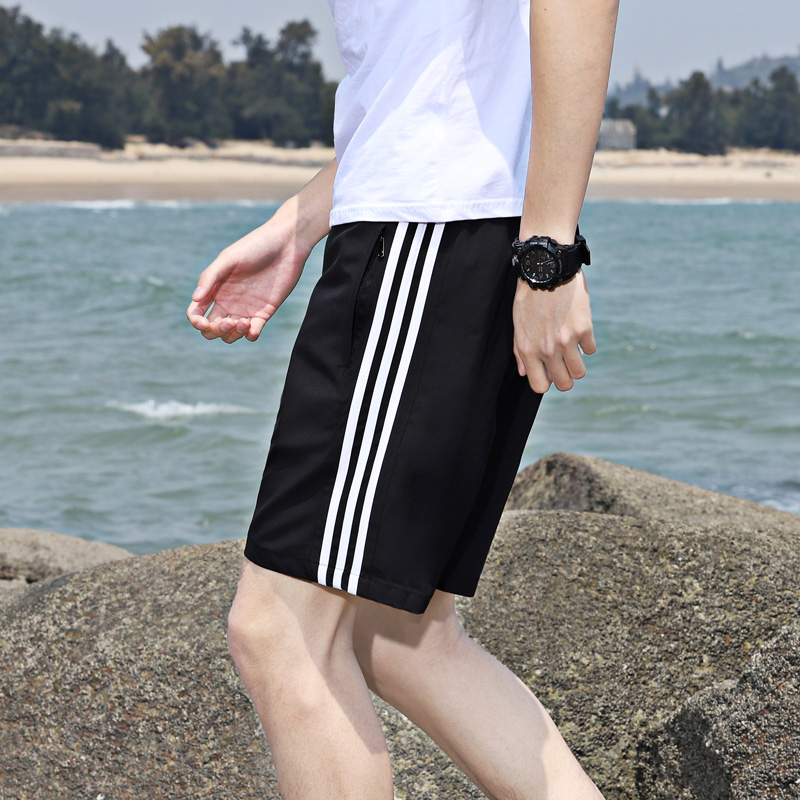 Summer sports shorts men's running speed dry stripe 5-point middle pants men's loose casual pants beach big underpants trend