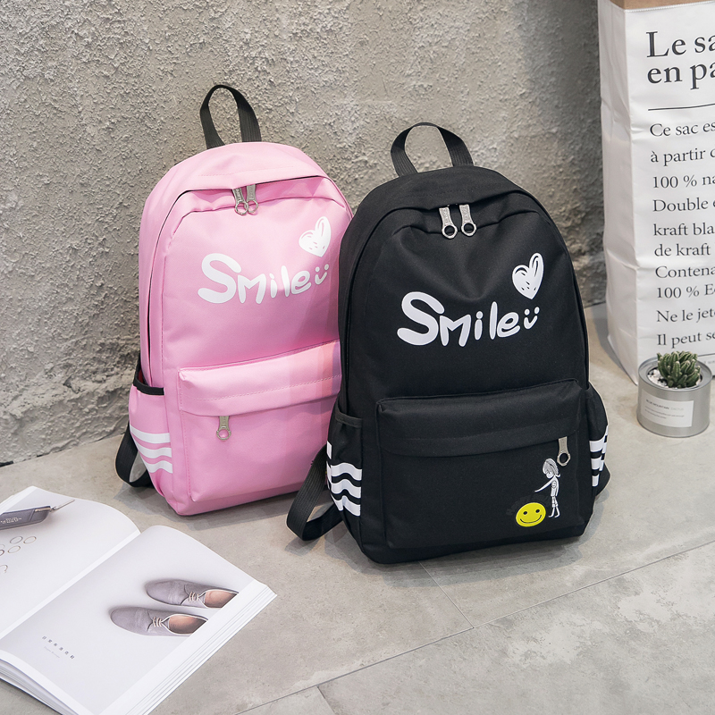 Large capacity canvas shoulder bag cute male and female junior high school students backpack schoolbag letter cartoon computer bag