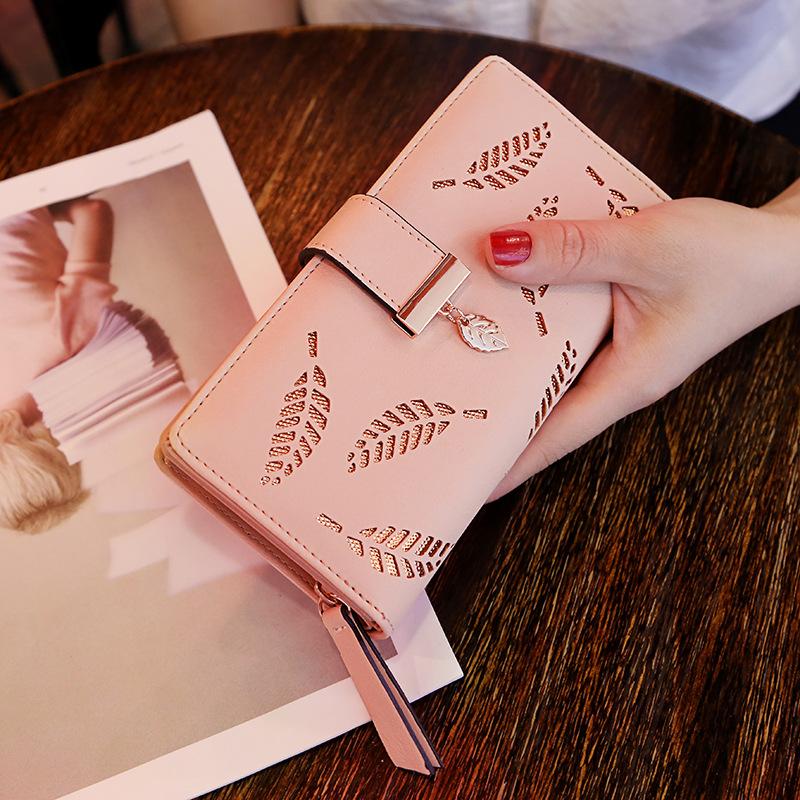 2020年女士网红长款时尚手拿镂空树叶拉链搭扣卡位钱包全国包邮