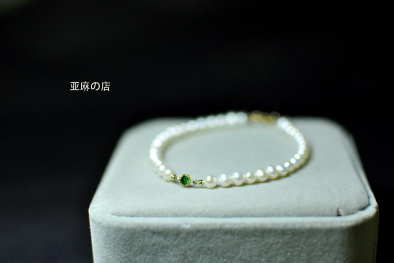 Natural freshwater pearl 4-5mm near round Aurora white pearl bracelet with 14K gold-plated green zircon ring buckle