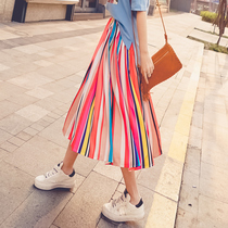 Colorful rainbow stripes over knee in a tall waist-bust skirt