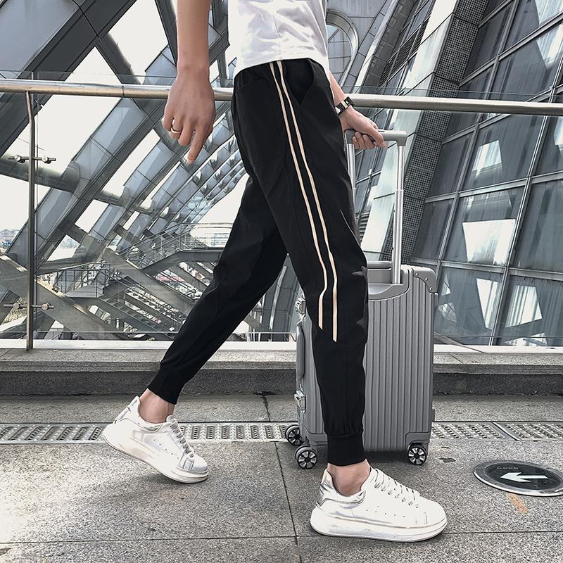 Striped long pants mens summer thin Korean fashion slim fit foot binding net red tide brand casual nine point Sweatpants