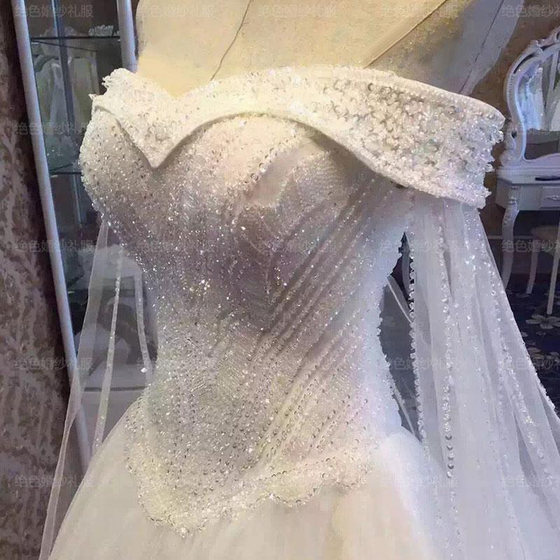 主なウェディングドレスの花嫁トレーディングプリンセスドリーム2020新式の結婚式の肩掛けの贅沢さを身につけています。