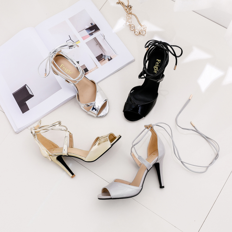 New products in spring and summer of 2018 comfortable European and American style metal Roman hollow high heel thin heel cross strap womens sandal round head