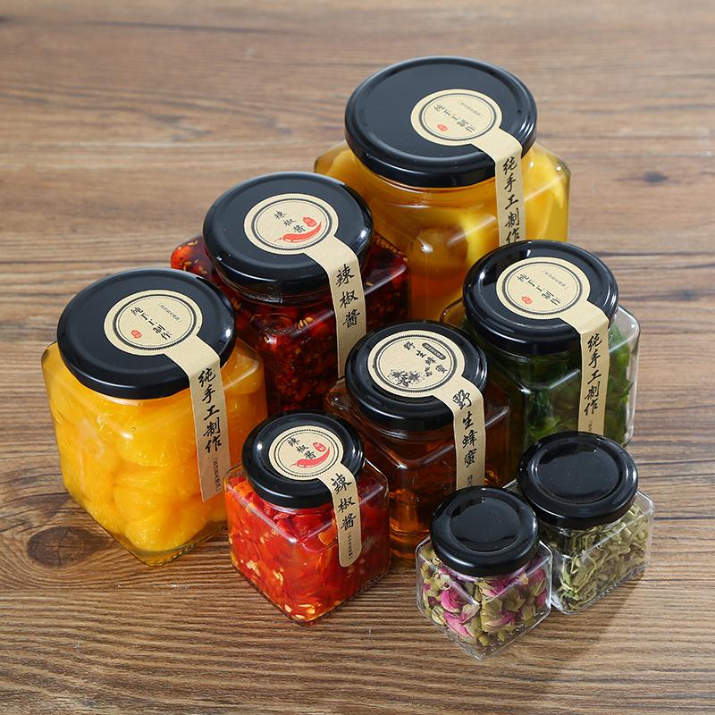 四方のガラスの瓶の蜂蜜は缶の食品級の腐乳の唐辛子のジャムの野菜を密封します。