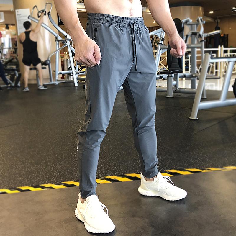 运动裤男秋季新款户外休闲跑步训练长裤宽松弹力速干收口健身卫裤