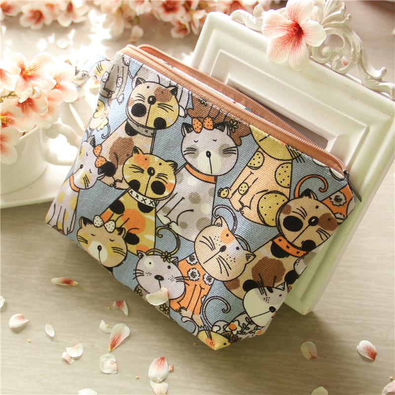 Womens cartoon bag Korean cosmetic Storage Bag Handmade pocket pocket pocket mobile phone zipper small size cloth bag