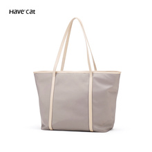 Tott Baggage Girl 2019 New Fashion Commuter Single Shoulder Large Hand-held Large Capacity Nylon Oxford Canvas Bag
