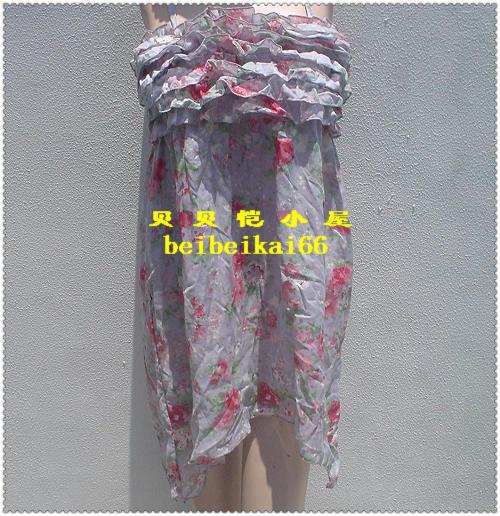 清商品の輸出は多頭商品で、日本ブランドのロマンチックな花畑風白菜のサスペンダースカート