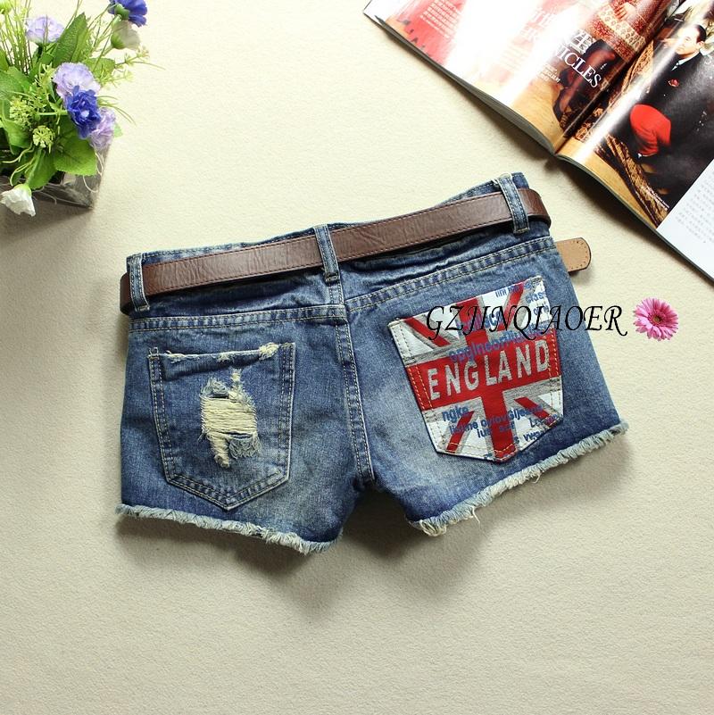 Универсальная низкой талии джинсы тонкий тонкий девочек осенью 2015 новых Burr отверстия в корейской версии свободные волны горячие брюки