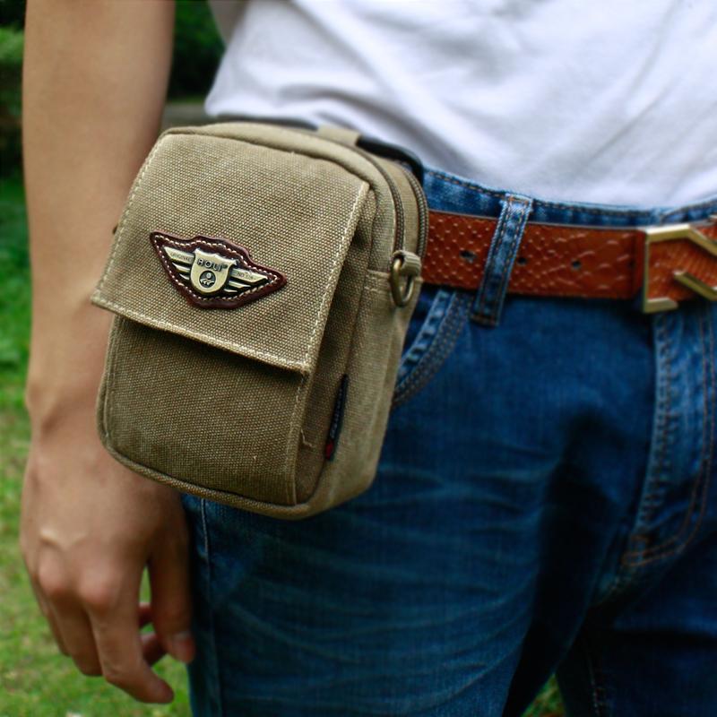夏の携帯電話の腰には男性のズックの小型仕事用のポケットがあります。