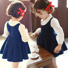 The new autumn 2015 Children girl han edition of pleated shirt splicing false two long-sleeved dress