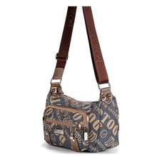 New trend of dressage dance step Korean version fashion multi-layer slanting canvas bag middle-aged and old mothers slanting across women's bag