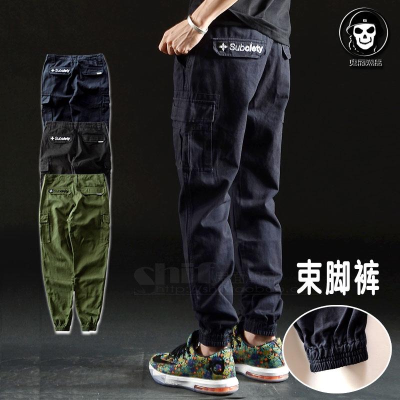 Оригинальный дизайн и уличной моды, большой карман брюки костюм брюки конические ноги сжать ноги тонкие брюки мужские