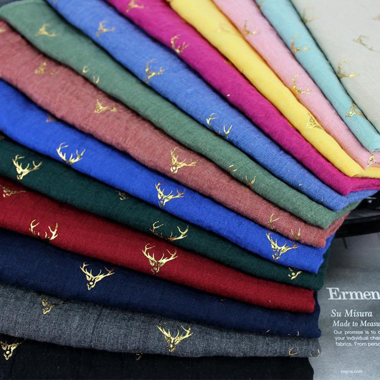 秋冬の韓国版の超大型リネンストールのスカーフの2つは、女性用の長い金の鹿の暖かさを使用して綿麻のマフラーの潮を暖めます。