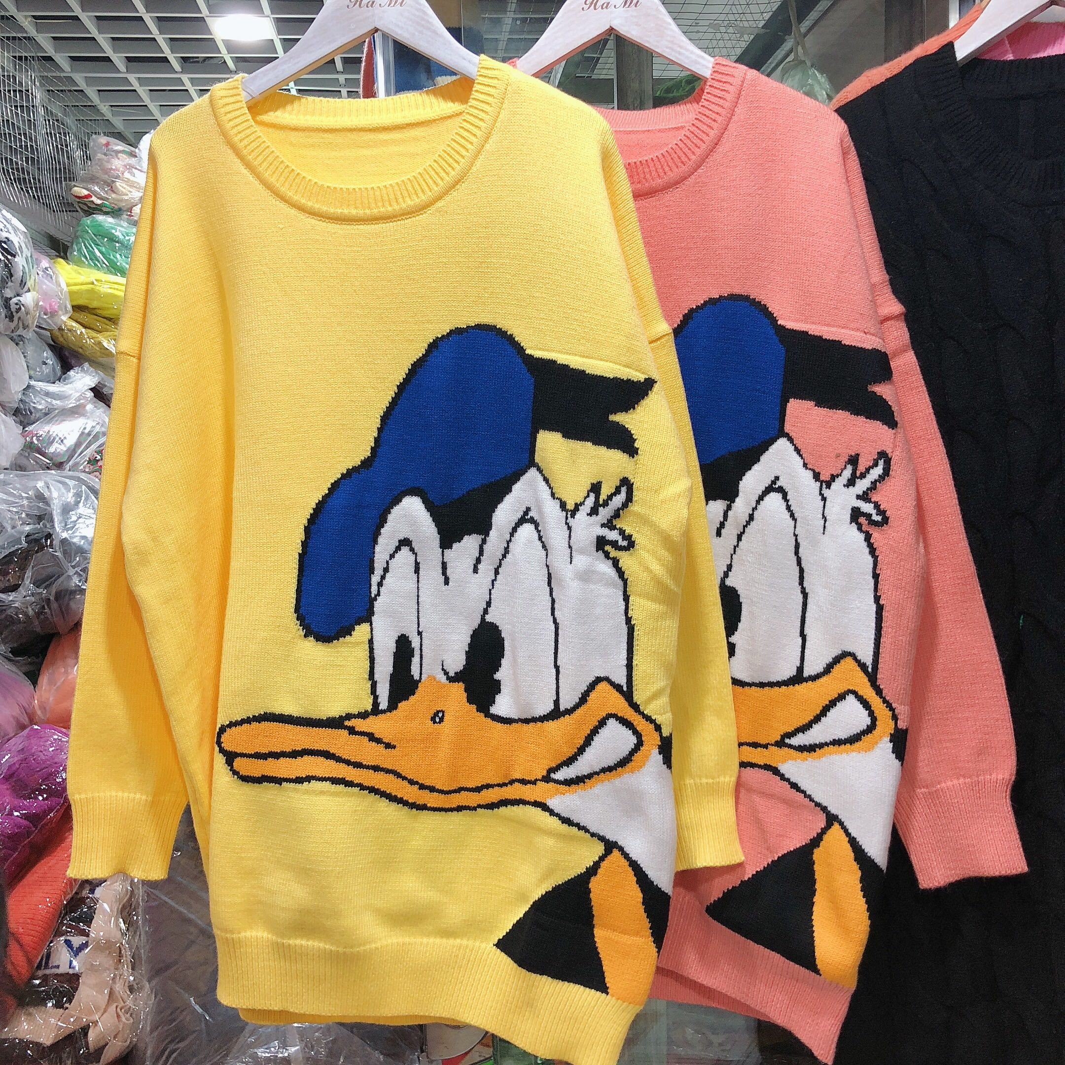 South Korea East Gate 2019 new sweet and lovely cartoon Donald Duck pattern loose T-shirt Pullover Sweater female