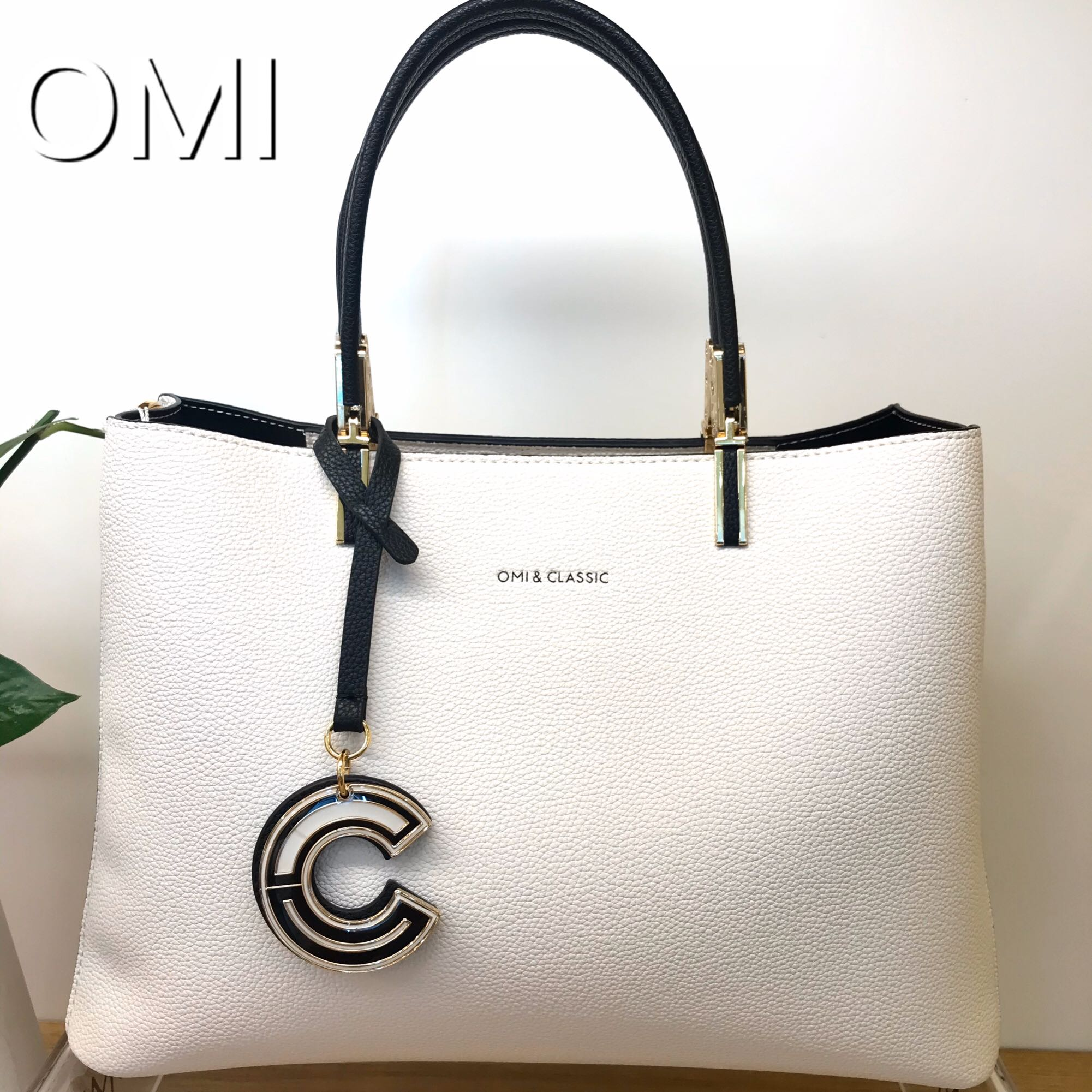 OMI Omi Omi Omi Ug純白バッグファッションシンプルOL風シリーズ高級感牛革ショルダーショルダー