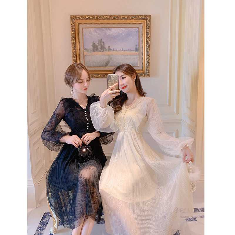 Photo shoot early spring new fairy lady Sequin mesh dress female trumpet sleeve temperament mid long skirt