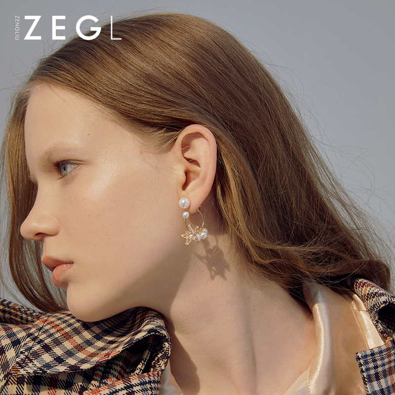 Zengliu advanced sense earrings with pearl like earrings hanging behind them