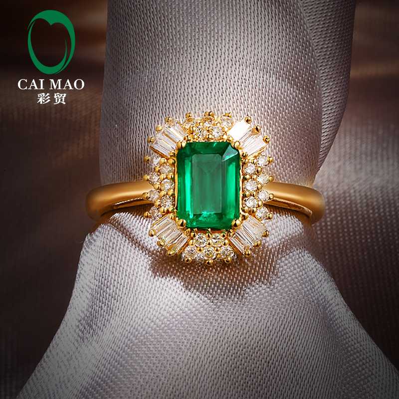 1.02 carat emerald ring with 38 points diamond and 18K gold color gem