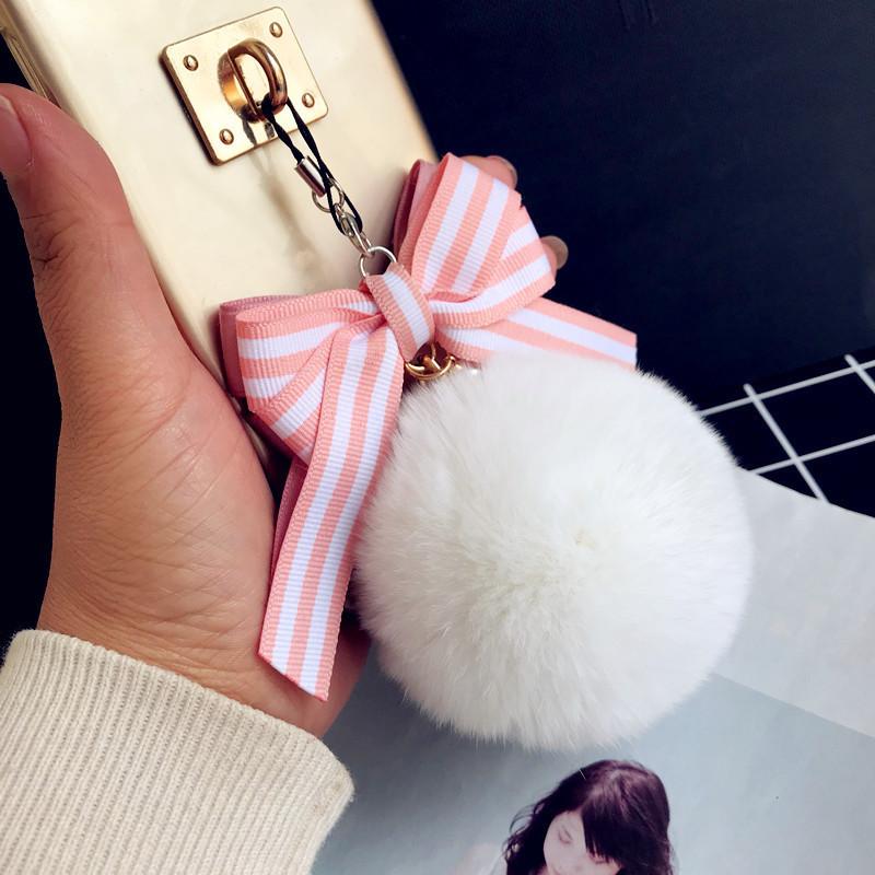 新款蝴蝶结糖果色獭兔毛球手机链包挂件可爱创意相机U盘毛绒吊坠
