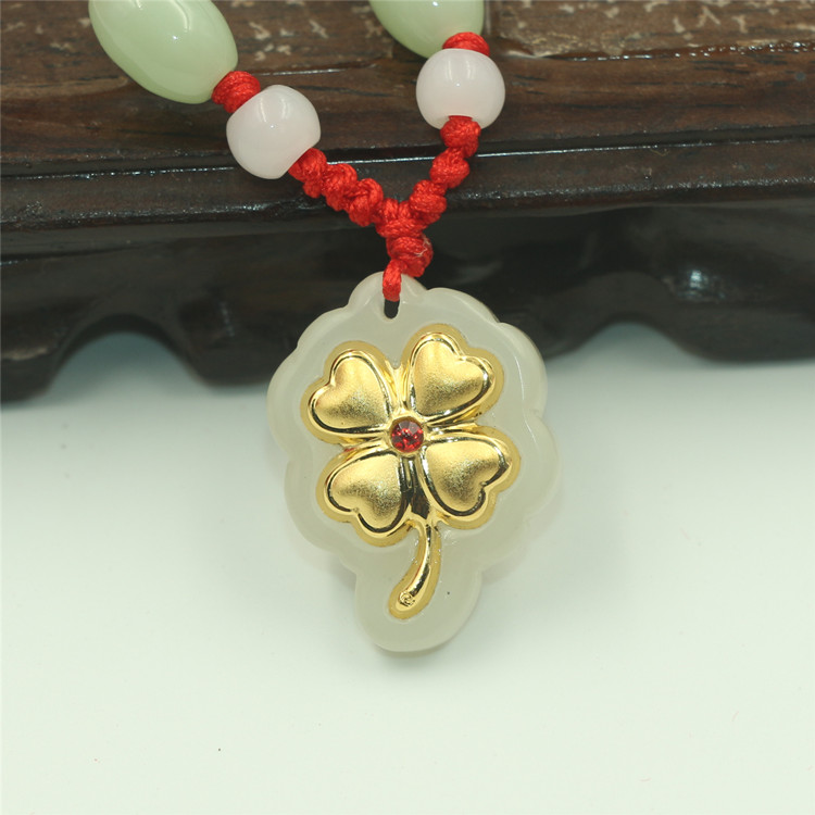 Natural Hetian jade pendant for girlfriend jewelry 99 gold inlaid jade red diamond four leaf grass jade pendant lettering