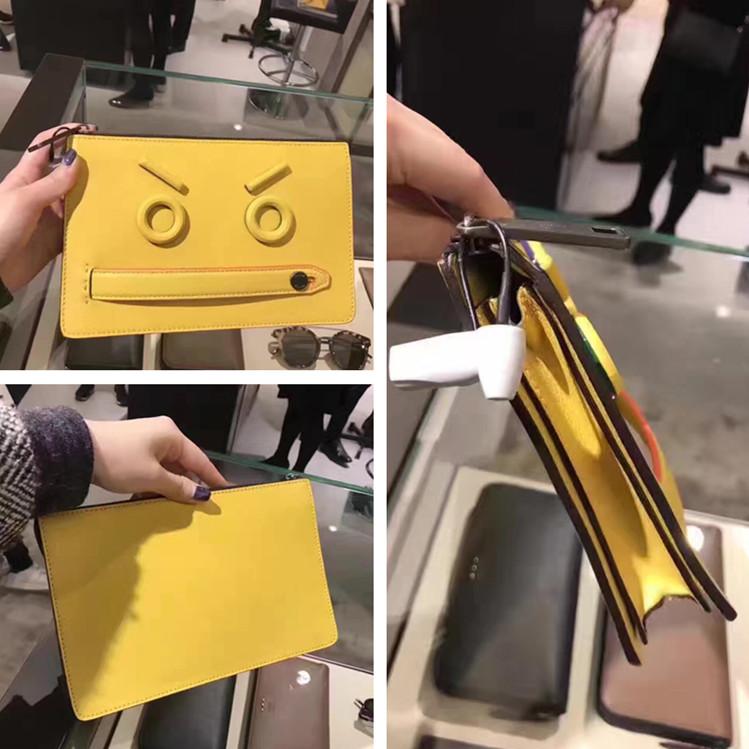 FENDI芬迪 新款黄色男士浮雕表情荔枝纹手插包黄色手拿包男包手包