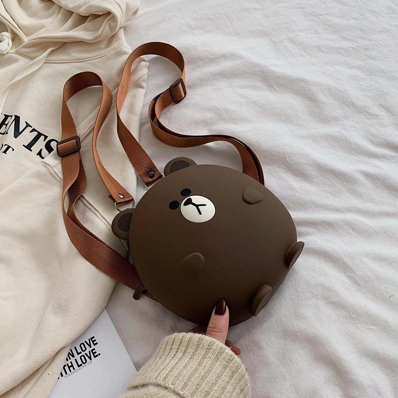 ネットの赤いシリコンゴムの小さい熊の女性のかばん2019秋冬の新型のかわいい漫画の肩のリュックサックの多機能の単に肩の斜めなショルダーバッグ
