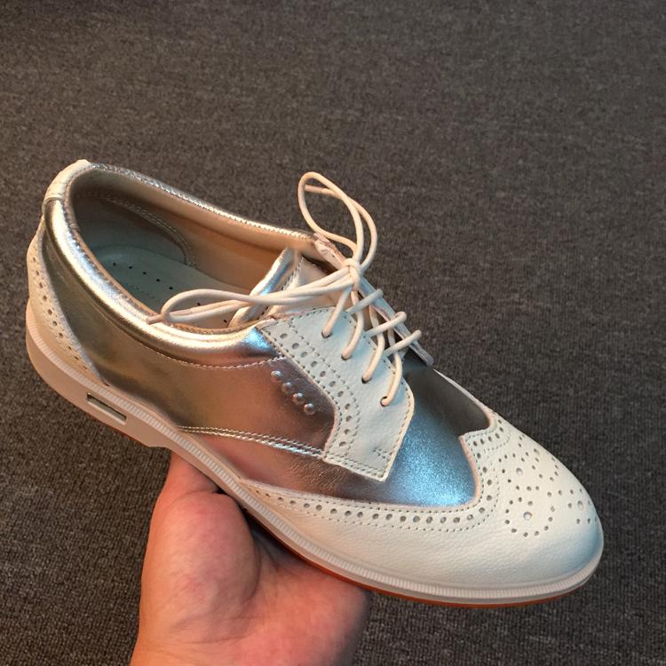 新款真皮白色高��夫球鞋女golf布洛克英��雕花平底休�e鞋�\�有�