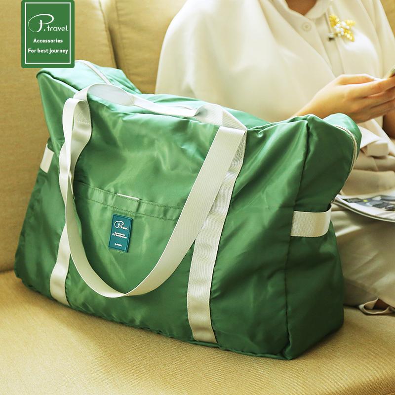 Mens and womens folding travel bag waterproof luggage bag large capacity thickened portable storage bag boarding hanging bar