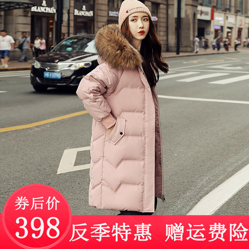 Down jacket womens middle and long 2020 new popular Korean fashion loose thickened white duck down hooded over the knee jacket