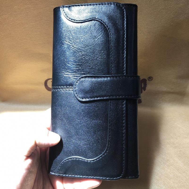 ヒッピー牛革財布の立体感のある財布です。女性用の黒い財布のトップ層の牛革黒い水晶の牛革を挟みます。