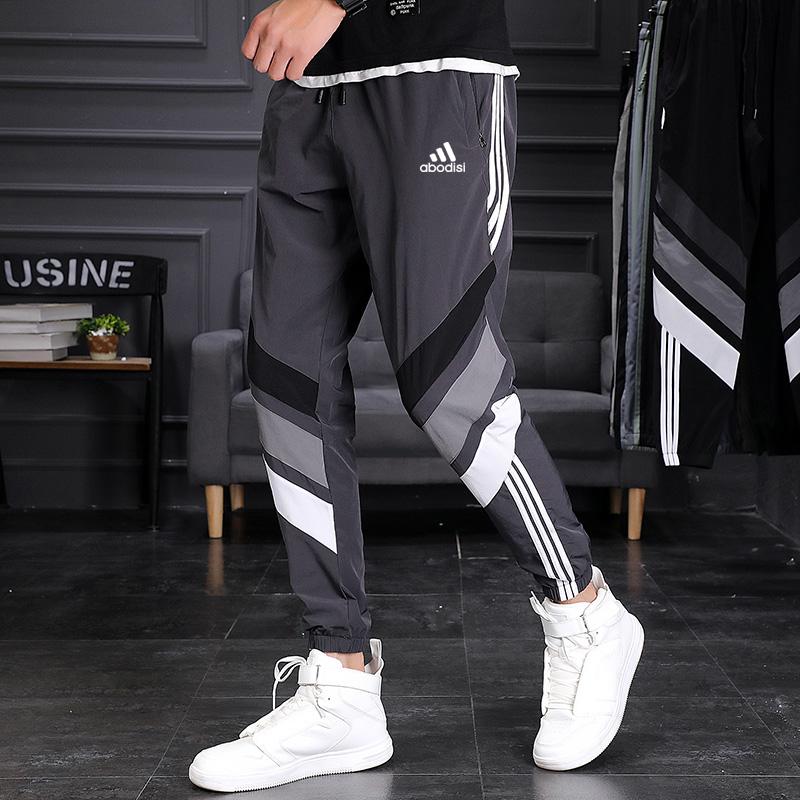 ブランドのズボンの男性2021新型の夏のスポーツズボンの大きいサイズの弾力の空気を通す小さい足のズボンのカジュアルなズボン