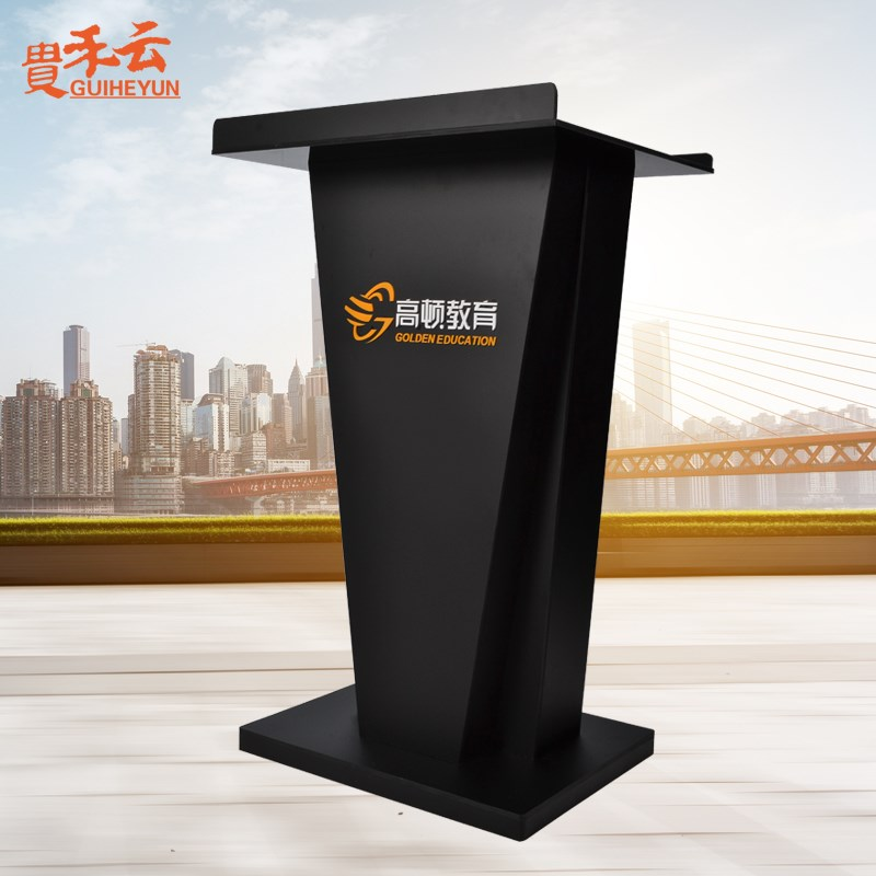White acrylic presides over the speech stage welcome reception desk speech conference chair table in front of small vertical Sales Department