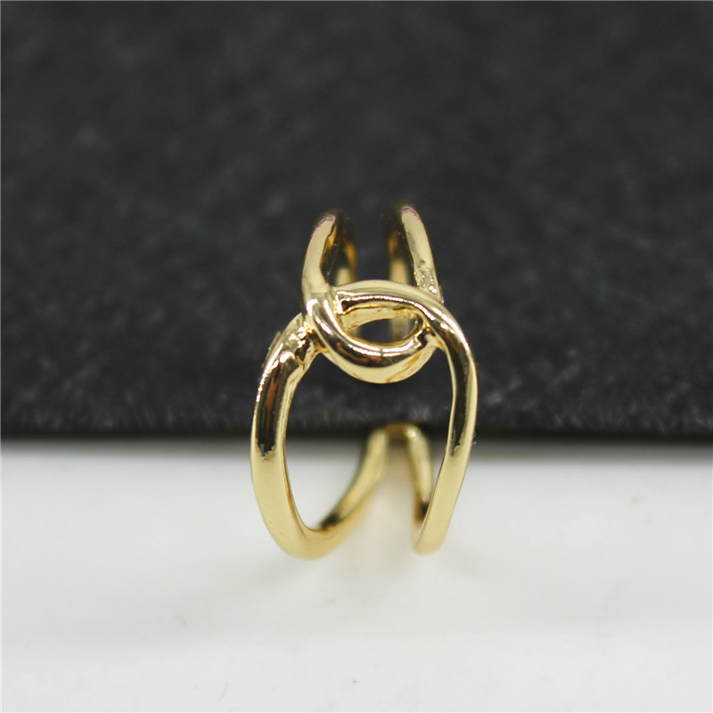 Niche cross opening ring womens fashion knot double button ring niche design jewelry cross border new accessories