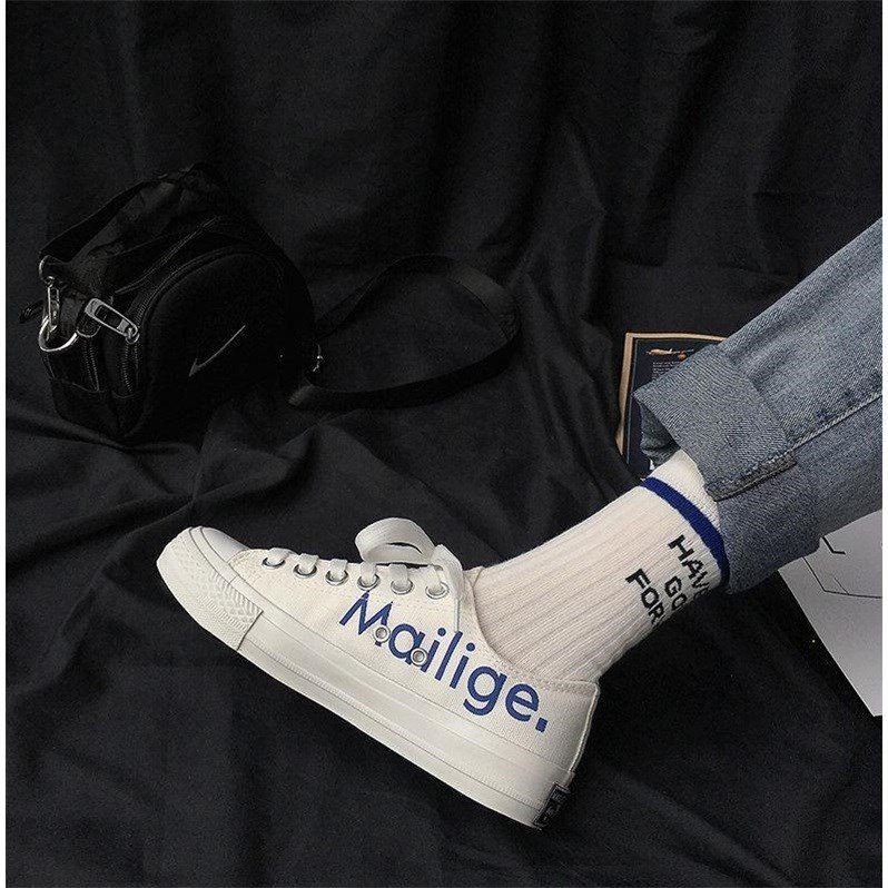 字母印花涂鸦滑板鞋女2020新款潮鞋港风街拍学生韩版百搭帆布鞋子