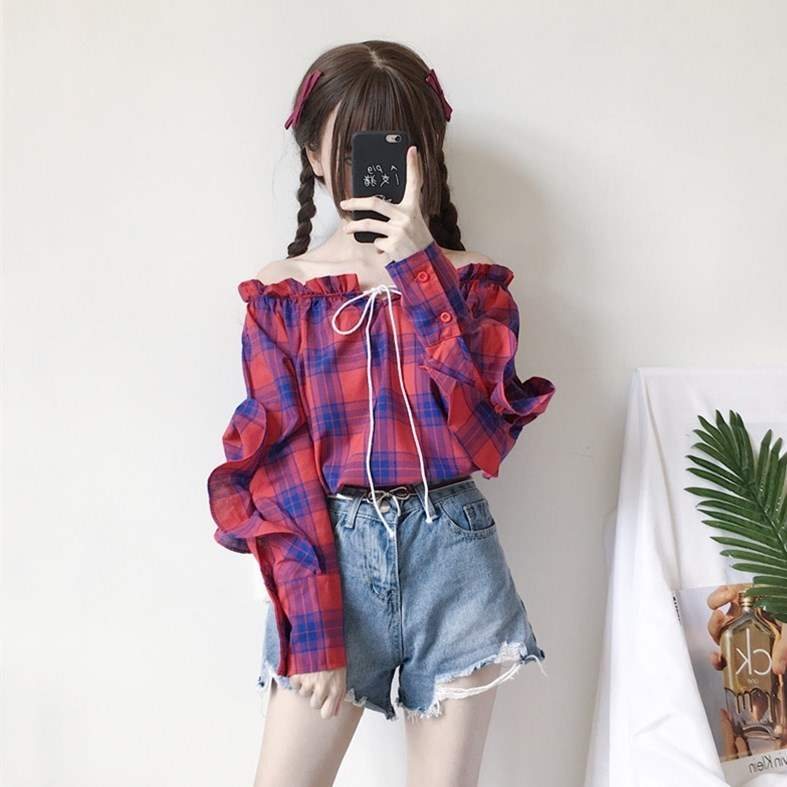Early autumn Korean elastic lace up one line collar Plaid personality hollow out Ruffle long sleeve shirt female student top fashion