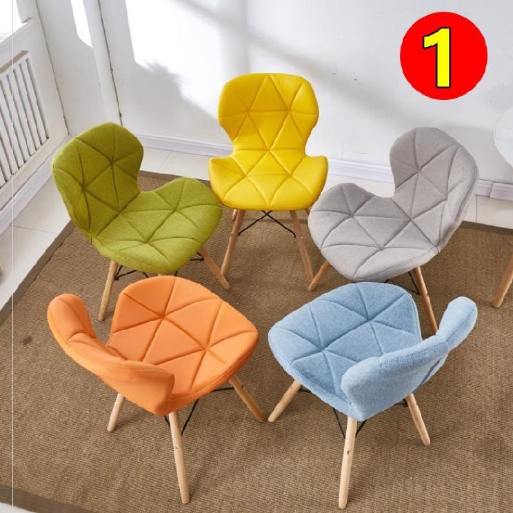 中式舒适伊姆斯办公椅靠背餐桌椅。黄色快餐店用粉色白椅子单人