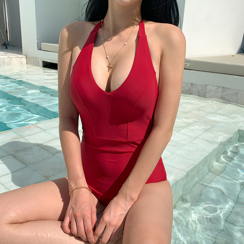 Special bikini new all-in-one triangle sexy slim body covering belly showing slim open back hot spring bathing suit female red black