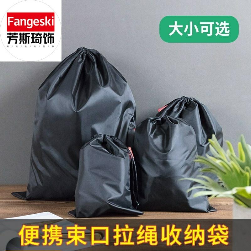 束口收纳袋黑色防水运动收纳包衣服玩具小布袋便携抽绳袋。