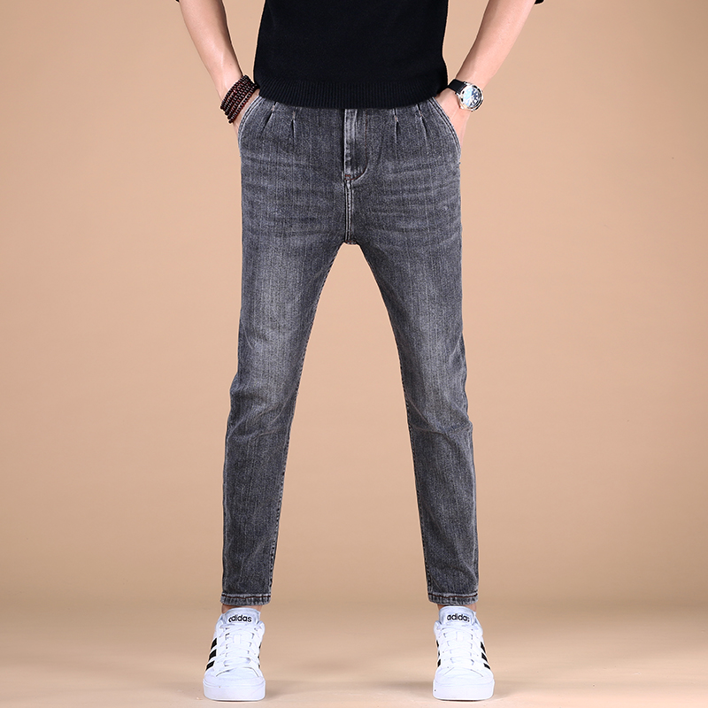 Elastic jeans mens small feet 2021 casual pants spring and autumn mens slim fit trend tide brand broken hole net red Korean version