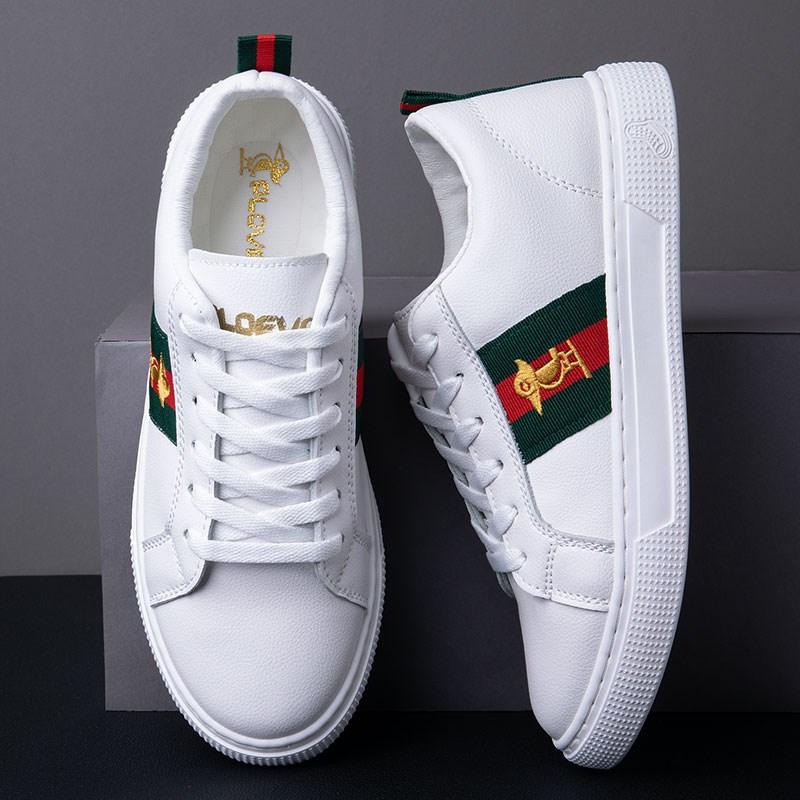 啄木鸟情侣鞋低帮鞋男士时尚舒适不磨脚板鞋男鞋小白鞋女鞋。