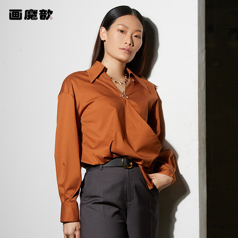 Painted magic Xin 2021 spring new style personalized big pointed Lapel waist twist buckle oblique Lapel blouse blouse