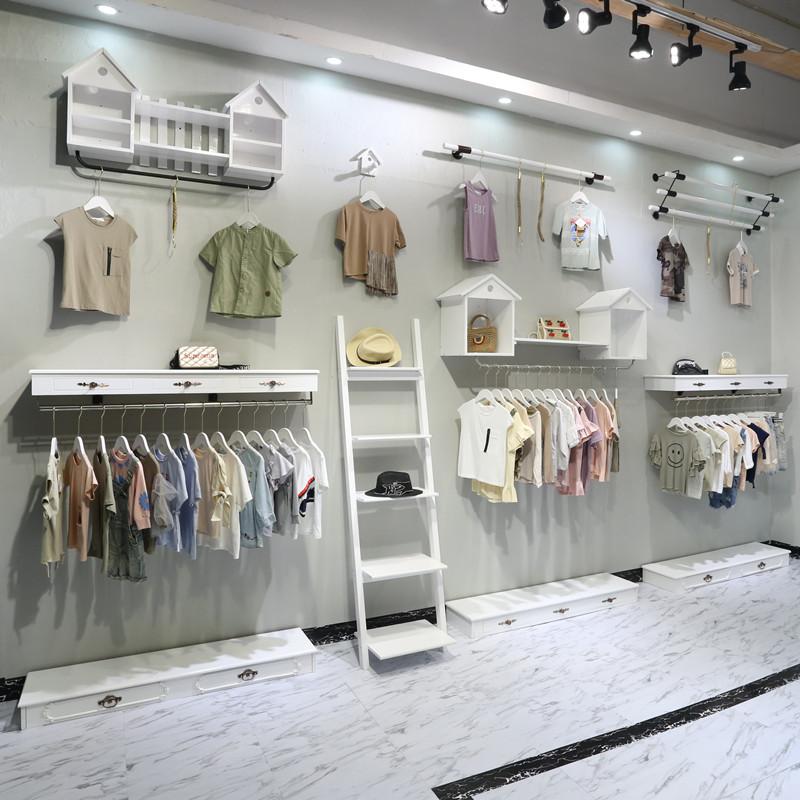 11月28日最新优惠童装店服装组合货架白色木质壁挂