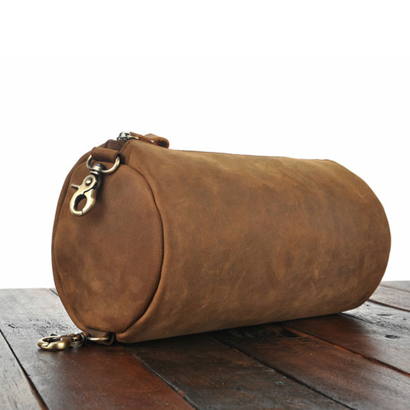 Leather fashion cylinder wrapped in oil wax leather one shoulder messenger bag, simple and retro round creative knapsack in cow leather