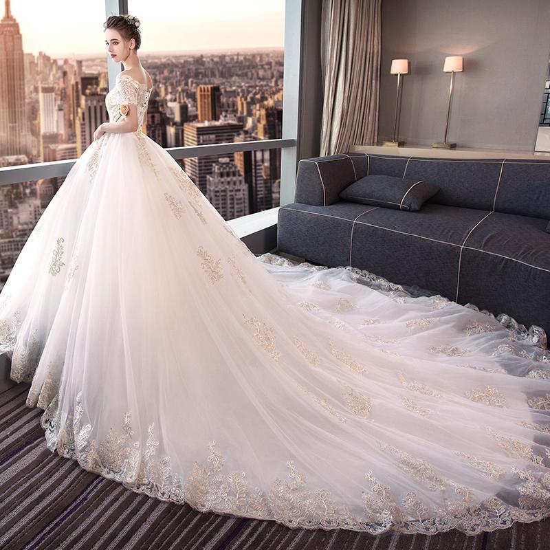 婚纱礼服新娘2018新款梦幻公主长拖尾显瘦一字肩欧美白色宫廷大码